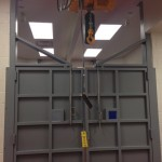Surgery room doors with hoists and a transport system for large animals.