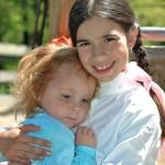 Gracie K and Jane G. cuddling, circa 2006